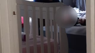 Dad Struggles to Change Baby's Diaper