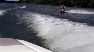 Red shorts wake board faceplant - Video