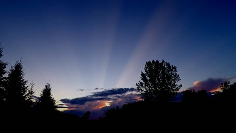 Rare sunlight rays streak across entire sky