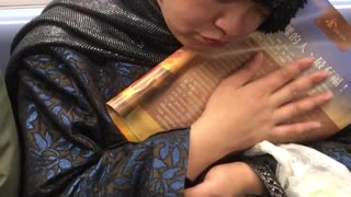 Woman cuddles and caresses book
