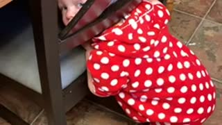 Toddler gets her head stuck in a chair