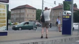 Funny guy randomly starts dancing in a tram station  - Video