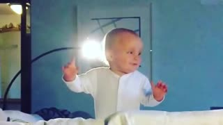 Cute little boy learning to stand up - falls repeatedly  - Video