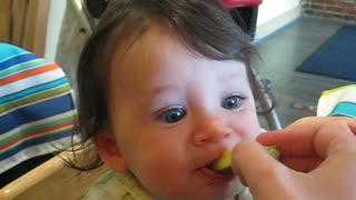 Baby Girl Makes Hilarious Face Trying Sour Pickle For The First Time - Video
