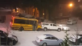 School Bus of Kids Slides Down Icy Hill and Crashes - Video