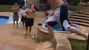 Pool jump attempt goes painfully wrong - Video