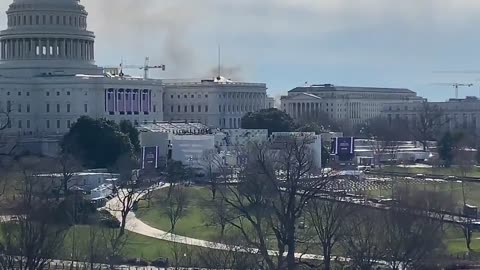Smoke behind Capitol. People Running from the inauguration stage