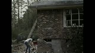 Brick Wall Almost Falls On Man After He Removes A Brick - Video