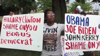 Immigrants From Haiti Protest the Clinton's Crimes Against Humanity