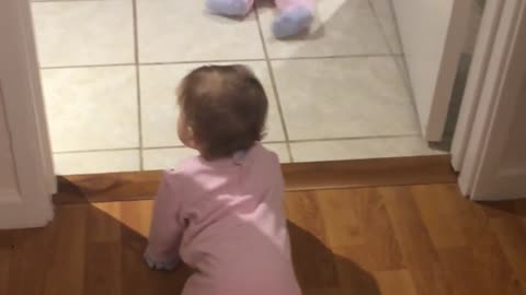 Identical twin baby girls crawl and chase each other for the first time