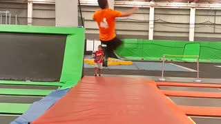 Guy in orange failed back flip in trampoline park