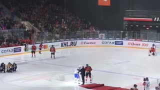 Hockey Game Guest Falls After Puck Drop