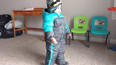Toddler Tries Out New Snowsuit