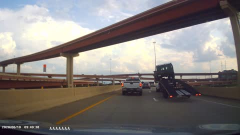 Top Heavy Trailer Causes Truck and Trailer to Tip