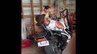 Sleeping man on motorcycle gets scare prank