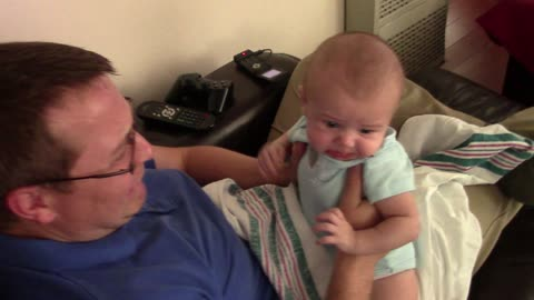 Adorable baby becomes sad when dad