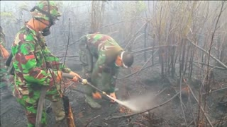 Efforts to stamp out Indonesian land fires continue - Video