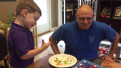 Toddler outsmarts dad at jellybean game