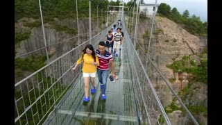 Scary glass bridge opens in China - Video
