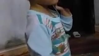 Baby Talks to Dad on Phone-Cute Little Baby Talking at Phone - Video