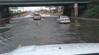 Vehicles drive through flooded underpass in Lindenhurst, NY - Video