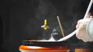 Levitating Top In A Smoke Bubble - Video