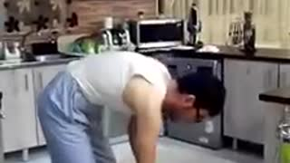Man working at home like a housewife - Video