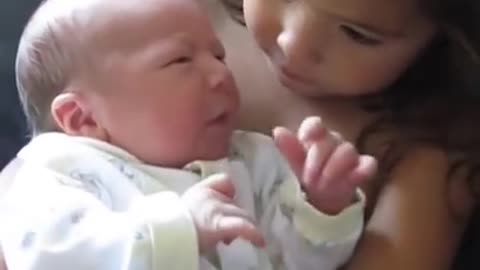 Big Sister Preciously Holds Newborn Baby Brother