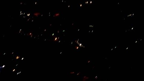 Cool firework display filmed from landing airplane