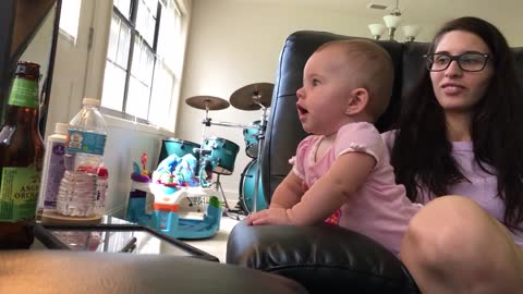 Baby sees her reflection, screams in excitement
