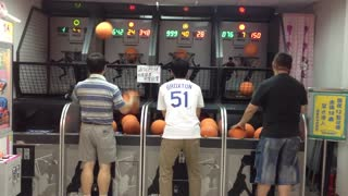 Man Shoots Hoops At The Arcade With Both Hands - Video
