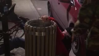 Guy in red jacket tries to jump over pole but falls back and hits butt on bike - Video