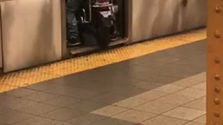 Man in white shirt drives motorcycle into subway train