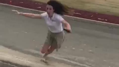 Banana peel thrown at girl she jumps over it and lands on it then slips