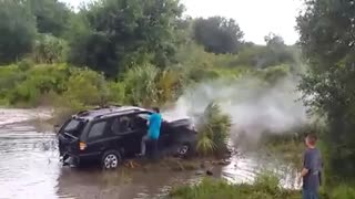 Stuntman in Training Jumps SUV Over a Creek - Video