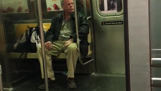 Old man yells about attacker on subway train - Video