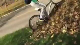 Guy in green shirt riding bike falls down - Video