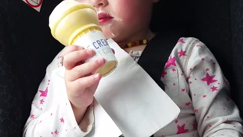 Little Girl Takes Nap Mid-Ice Cream Cone