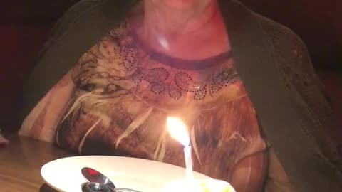 Sweet Grandma Has a Hard Time Blowing Out Candle