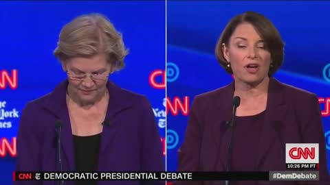 Warren Attacked by Debate Rivals on Health Care