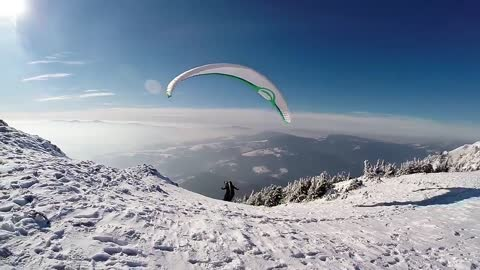 Epic paragliding from above the frozen Carpathian Mountains