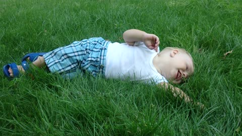 the child enjoys the thick grass.