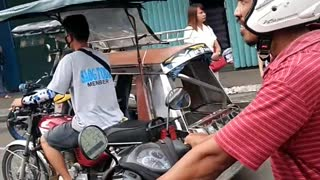 Biker Dangerously Carries Dog - Video