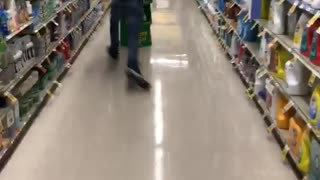 Guy runs into a grocery stand and knocks it down