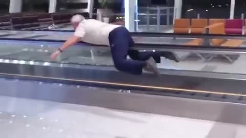 Old Man Swimming on Escalator decided to make his time on an escalator more fun