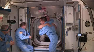 First time in history astronauts enter space station from private spacecraft