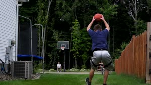 Basketball trick artist hits full court front flip shot - Video