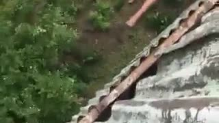 Shirtless man jumps off balcony - Video