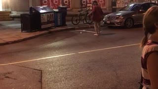 Street guy can't throw water bottle into trash
