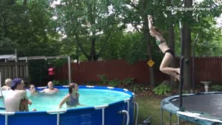 Girl tries to jump from trampoline to pool but slides on edge of pool - Video
